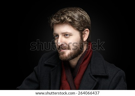 Elegant man wearing scarf and heavy coat