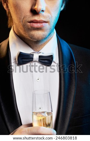 Elegant man with a champagne glass - stock photo
