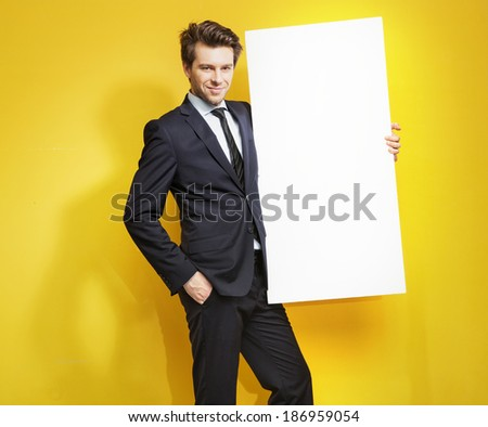 Elegant man with a white board  - stock photo