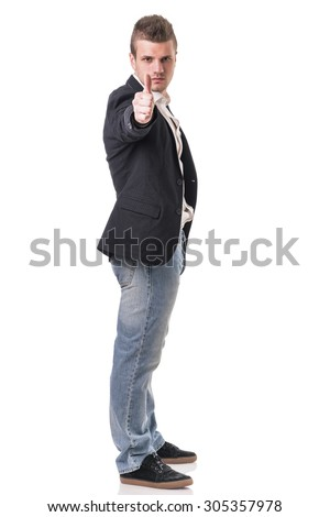 Elegant man with gun, dressed as a spy or secret agent, with earphones, isolated on white. Full figure shot - stock photo