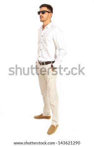 Elegant man with sunglasses looking away isolated on white background - stock photo
