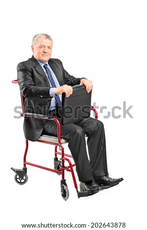 Elegant mature businessman sitting in wheelchair isolated on white background