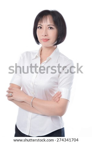 elegant middle aged woman in white dress portrait isolated in studio - stock photo
