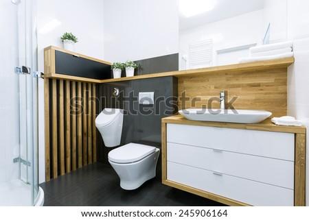 Elegant modern bathroom with black tiles - stock photo