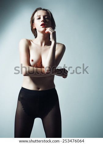 Elegant nude woman with short blond  hair. Studio portrait. - stock photo
