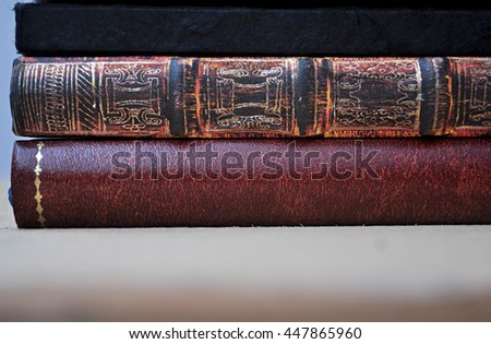 elegant old books piled up in good condition - stock photo