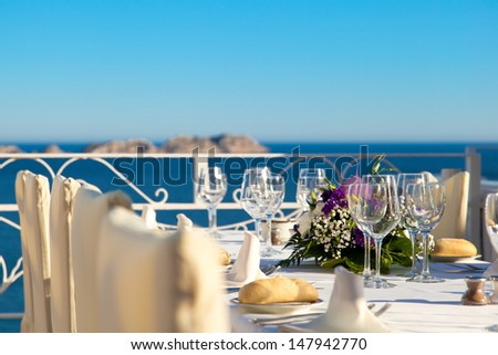 Elegant Outdoor Wedding Table with Sea Views - stock photo