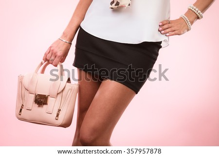 Elegant outfit. Female fashion. Girl in fashionable clothes holding bag handbag. - stock photo