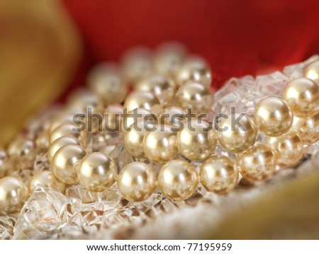 Elegant pearls over ice with ribbon very shallow depth of field