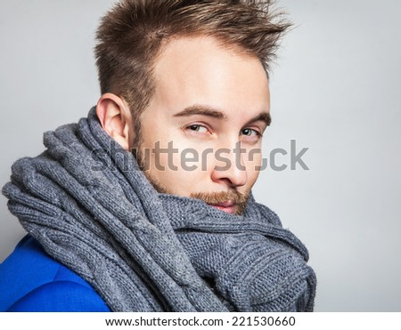 Elegant & Positive young handsome man in scarf. Studio fashion portrait.  - stock photo