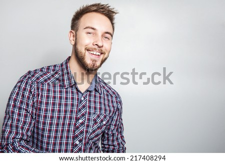 Elegant & positive young handsome man. Studio fashion portrait.  - stock photo