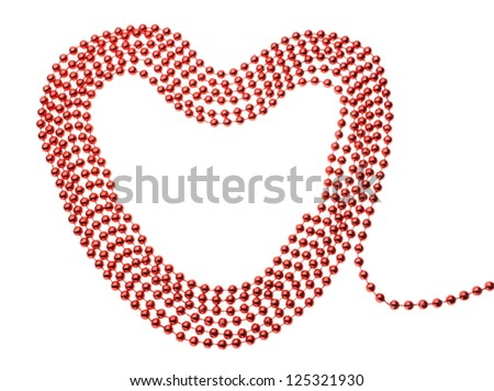 Elegant red beads in the shape of a heart. On a white background.
