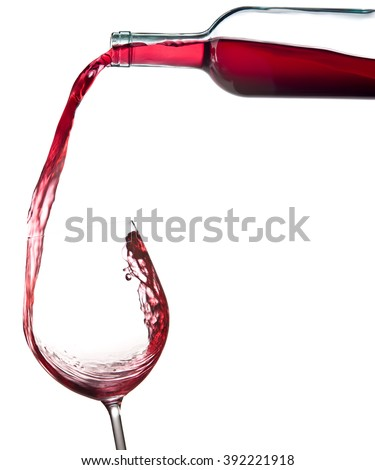 elegant red wine bottle pour glass isolated on white - stock photo