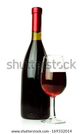 Elegant red wine glass and a wine bottle isolated on a white background  - stock photo