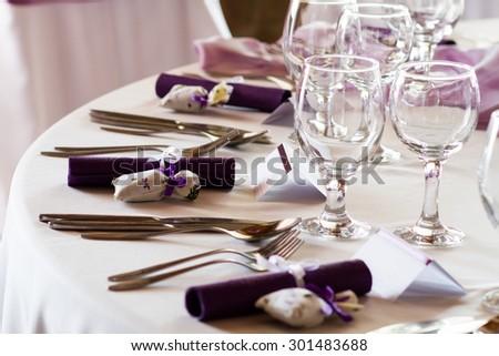 elegant restaurant table set for event, wedding place - stock photo