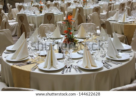 Elegant restaurant tables set for a business event, banquet or wedding - stock photo