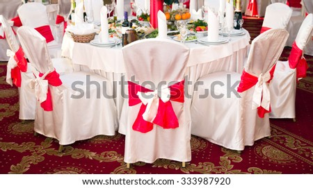 Elegant round party table. Setting could be for a wedding, birthday, or any occasion. - stock photo