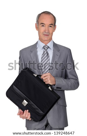 Elegant senior man on white background