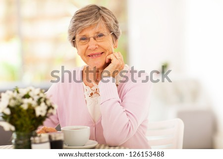 elegant senior woman having tea - stock photo