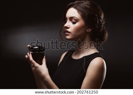 Elegant sensual young woman holding perfume, Fashion photo  - stock photo
