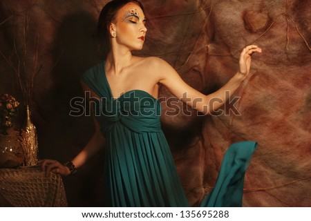 elegant sensual young woman in blue dress - stock photo