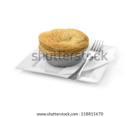 Elegant setting puff pastry meat pie with a foil base. Concept image for fast food, junk food or comfort food. Soft shadows against a white background. Copy space. - stock photo