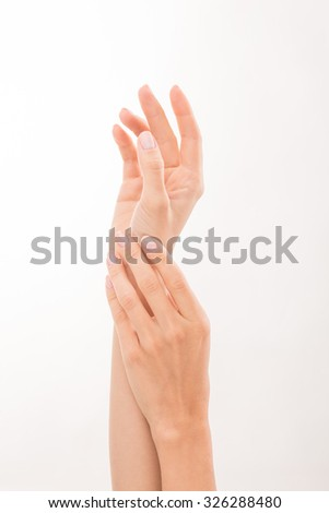 Elegant skin of two white woman's hands showing close relations. Two hands demonstrating skincare over white background.