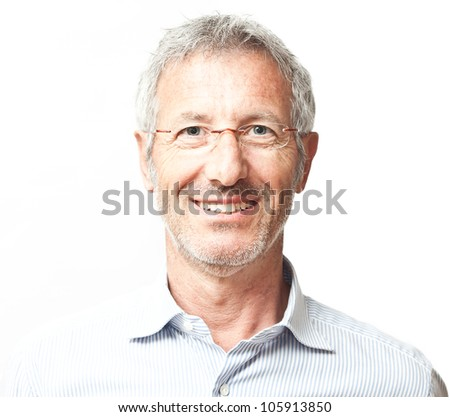 Elegant smiling mature man portrait wearing a pair of glasses isolated on white background - stock photo