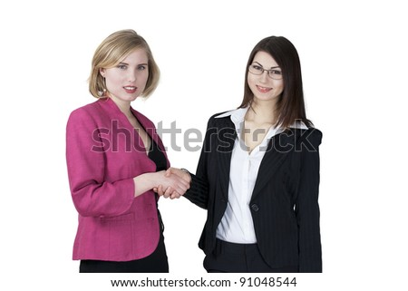 Elegant smiling young businesswomen shaking hands on making a deal - stock photo