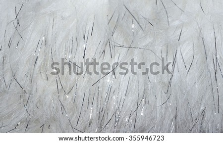 Elegant soft white faux fur with sparkle, abstract textured luxury background or backdrop. Festive holiday sparkle background.