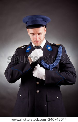 elegant soldier wearing uniform in studio - stock photo