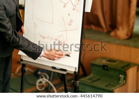 elegant speaker lecturer drawing financial charts at white board, at meeting, business marketing lecture coaching - stock photo