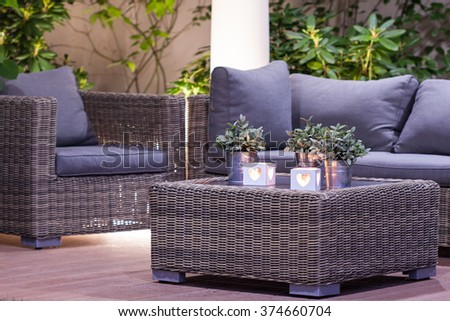Elegant stylish garden furniture in the arbour - stock photo