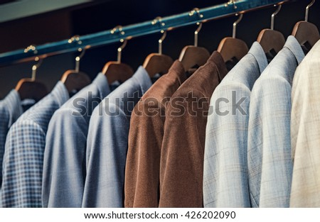 Elegant suits in a men clothing store