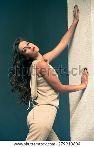 elegant summer fashion young woman wearing  golden overalls, shot in the city - stock photo
