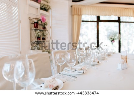 Elegant table arrangement and catering at wedding reception. Wedding decoration in restaurant - stock photo
