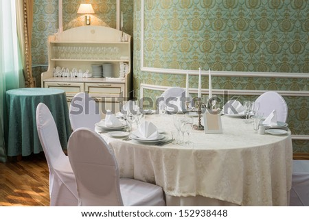 Elegant table in a restaurant decorated for a wedding celebration - stock photo