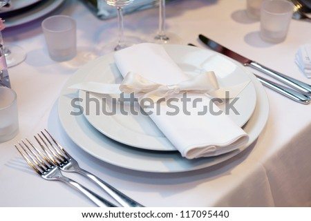Elegant table set for a wedding dinner - stock photo