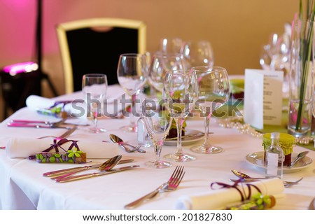 Elegant table set in lilac and green for wedding or event party, with give away for guests