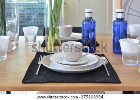elegant table set in modern style dining room interior