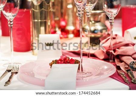 Elegant table set in soft red and pink for wedding or event party - stock photo