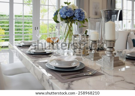 elegant table set in vintage style dining room interior - stock photo