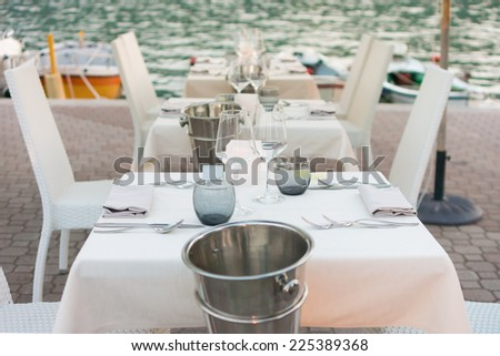 elegant table set on the sea - stock photo
