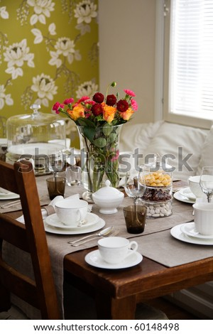 Elegant table setting for afternoon coffee or tea - stock photo