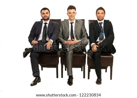 Elegant three business men sitting on chairs in a line isolated on white background