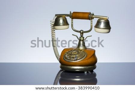 Elegant vintage phone on grey background - stock photo