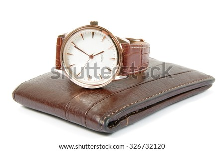 elegant watch and wallet on white - stock photo