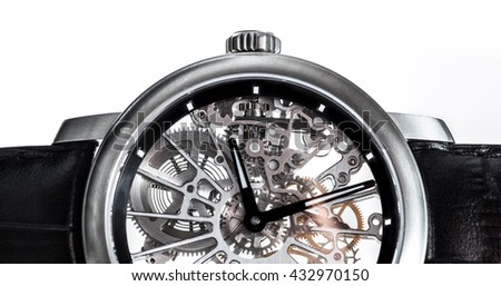Elegant watch with visible mechanism, clockwork close-up. Luxury, men's vintage accessory. Time, fashion concept. - stock photo
