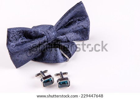 Elegant wedding bow and cufflinks for the groom. - stock photo