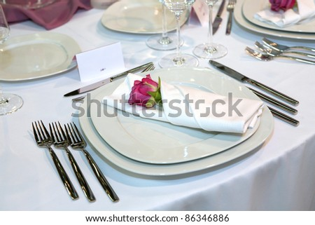 Elegant wedding dinner with red rose on a plate - stock photo